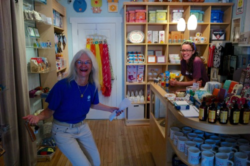 Barbara and Michelle at Seasons General Store in OG. Barbara cracks herself up. 2014. Paul Goldfinger photo. ©