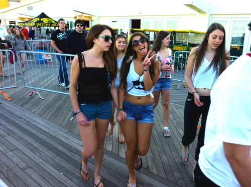 College girls at Bamboozle. What is she majoring in? Paul Goldfinger photograph on the A. Park boards. ©