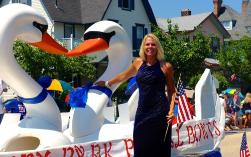 July 4 parade on Main Avenue in Ocean Grove. Running the swan show is Proprietor Linda Occhipinti.. Paul Goldfinger photo. ©