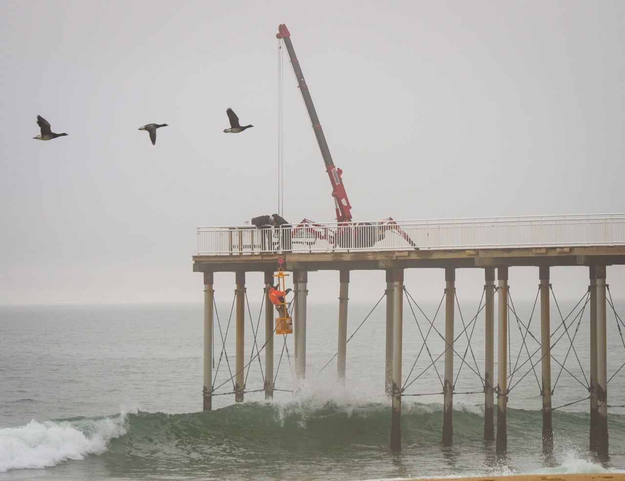 installing support cables on the belmar fishing pier bob