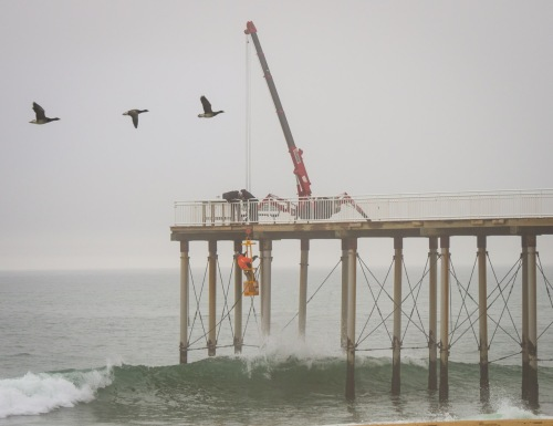 Belmar, NJ fishing pier. Installing support cables. By Bob Bowné. 2/23/17. © Special to Blogfinger