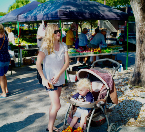 "Lakes Park Farmers Market. ""Mom with cell phone and baby makes 3."" Paul Goldfinger photo © 2/15/17"