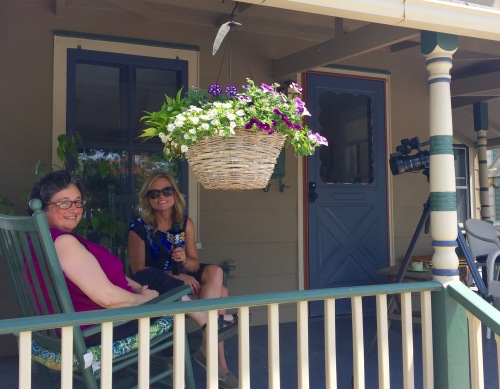 Meg Baker interviews Joyce Klein on Jersey Joyce's porch in Ocean Grove. 5/26/16. © Paul Goldfinger photo.